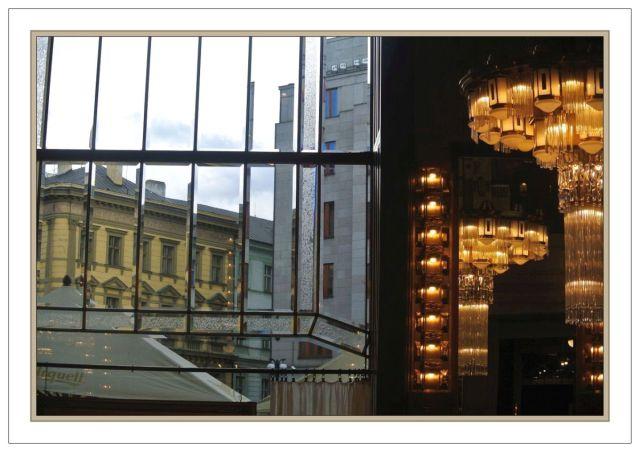 Prague Kavarna Obecni Dum chandelier reflections and window